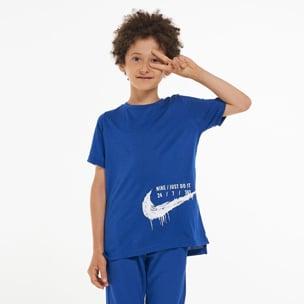 Kid posing in fashionable adidas tracksuit
